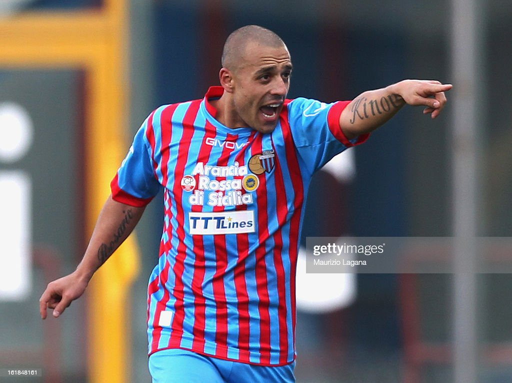 <a gi-track='captionPersonalityLinkClicked' href=/galleries/search?phrase=Sergio+Almiron&family=editorial&specificpeople=660934 ng-click='$event.stopPropagation()'>Sergio Almiron</a> of Catania celebrates after scoring the opening goal of the Serie A match between Calcio Catania and Bologna FC at Stadio Angelo Massimino on February 17, 2013 in Catania, Italy.