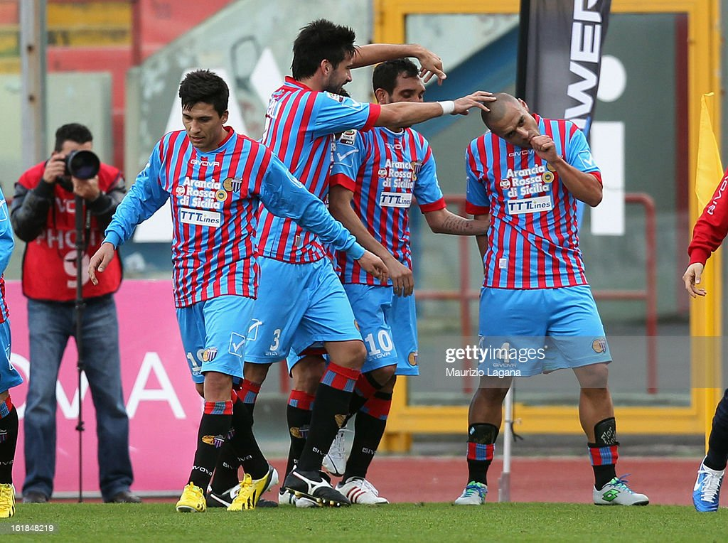 <a gi-track='captionPersonalityLinkClicked' href=/galleries/search?phrase=Sergio+Almiron&family=editorial&specificpeople=660934 ng-click='$event.stopPropagation()'>Sergio Almiron</a> (R) of Catania celebrates with team-mates after scoring the opening goal of the Serie A match between Calcio Catania and Bologna FC at Stadio Angelo Massimino on February 17, 2013 in Catania, Italy.