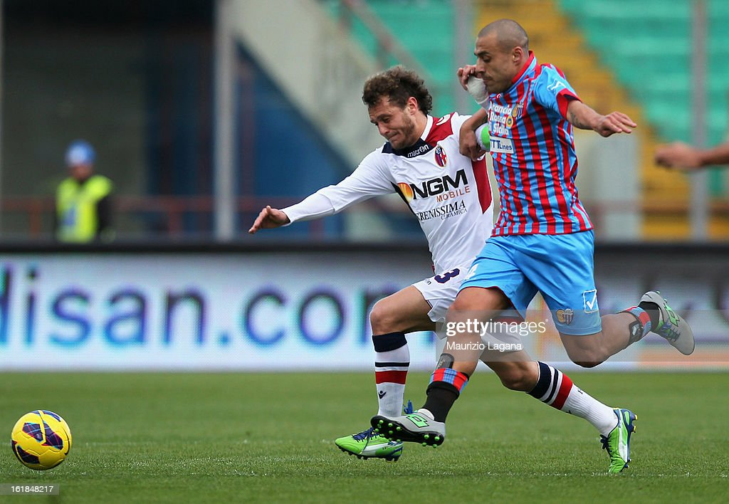Sergio Almiron of Catania (R) competes for the ball with Alessandro Diamanti of Bologna during the Serie A match between Calcio Catania and Bologna FC at Stadio Angelo Massimino on February 17, 2013 in Catania, Italy.