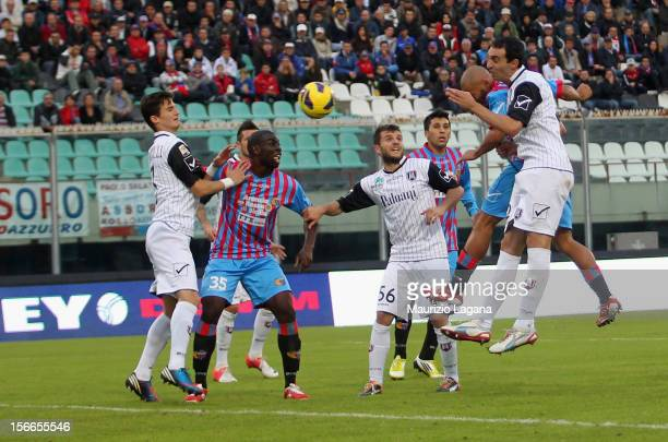 Sergio Almiron of Catania scores his team's opening goal during the Serie A match between Calcio Catania and AC Chievo Verona at Stadio Angelo...