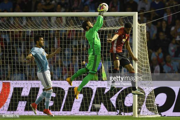 Sergio Alvarez of RC Celta in action against Marcus Rashford of Manchester United during the UEFA Europa League semi final first leg match between...
