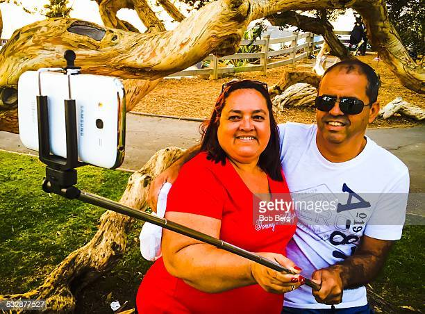 Santa Monica Ca January 9 2015 Sergio and Rita Barreto visiting from Brazil take a couple selfie with a selfie stick