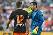 Sergio Ayala of Valencia CF goalkeeper Diego Alves of Valencia CF during the preseason friendly match between Feyenoord and Valencia on July 23 2016...