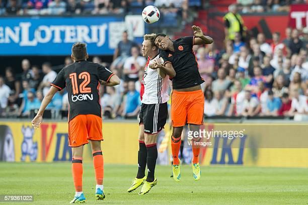 Sergio Ayala of Valencia CF Nicolai Jorgensen of Feyenoord Aderlan Santos of Valencia CF during the preseason friendly match between Feyenoord and...
