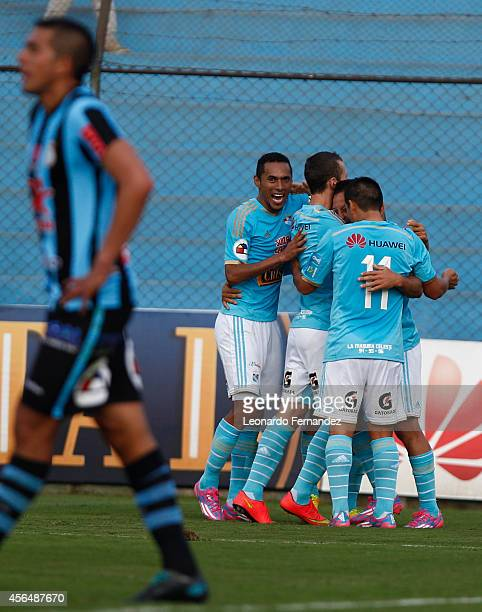 Sergio Blanco of Sporting Cristal of Sporting Cristal celebrates with his teammates after scoring the first goal of his team during a match between...