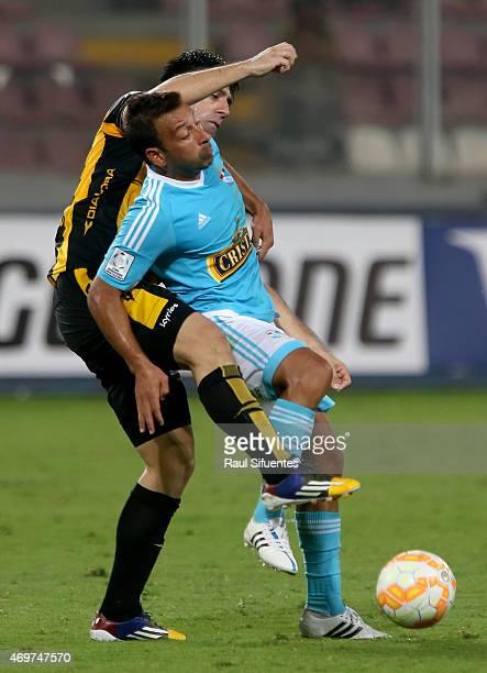 Sergio Blanco of Sporting Cristal struggles for the ball with Ruben Maldonado of Guarani during a match between Sporting Cristal and Guarani as part...