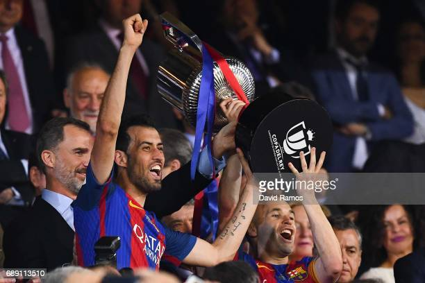 Sergio Busquets and Andres Iniesta of FC Barcelona hold up the trophy after winning the Copa Del Rey Final between FC Barcelona and Deportivo Alaves...