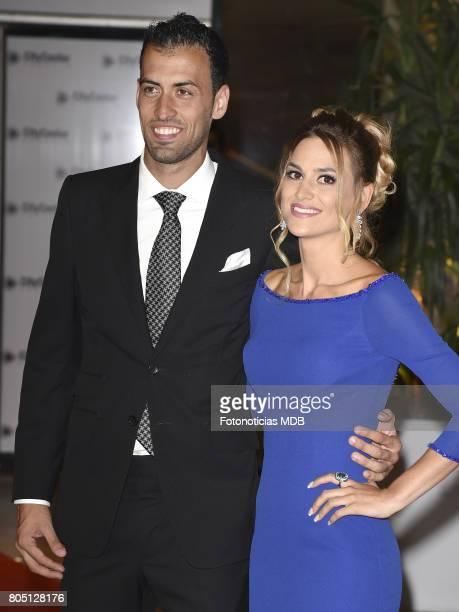 Sergio Busquets and Elena Galera attend Lionel Messi and Antonela Rocccuzzo's wedding at the City Center Rosario Hotel Casino on June 30 2017 in...