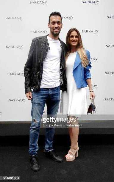 Sergio Busquets and Elena Galera attend the opening of Sarkany Shoes Boutique on May 17 2017 in Barcelona Spain