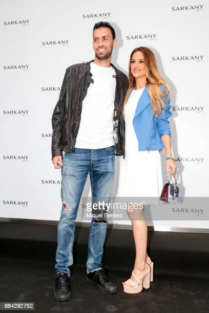 Sergio Busquets and Elena Galera attend the Sarkany Shoes Boutique Openeing in Barcelona on May 17 2017 in Barcelona Spain