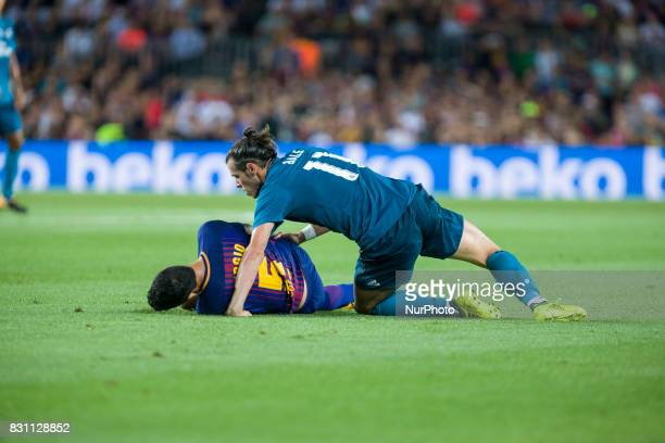 Sergio Busquets and Gareth Bale during the match between FC Barcelona Real Madrid for the first leg of the Spanish Supercup held at Camp Nou Stadium...