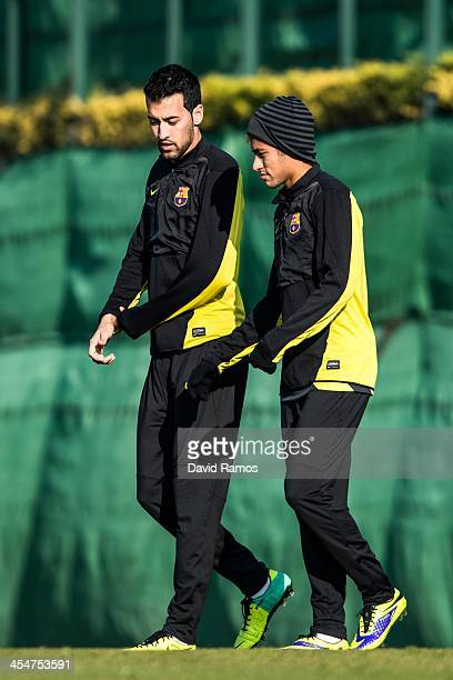 Sergio Busquets and Neymar of FC Barcelona chat during a training session ahead of their UEFA Champions League Group H match between FC Barcelona and...