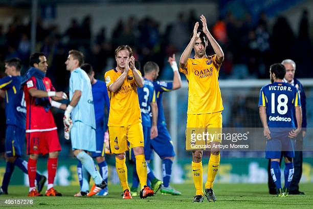 Sergio Busquets Burgos of FC Barcelona and his teammate Ivan Rakitic greets their fans after wining the La Liga match between Getafe CF and FC...