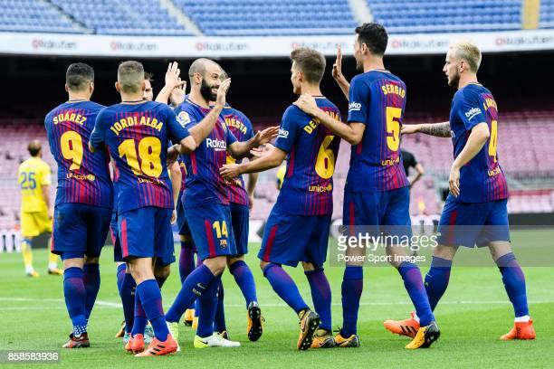 Sergio Busquets Burgos of FC Barcelona celebrates after scoring his goal with his teammates during the La Liga 201718 match between FC Barcelona and...