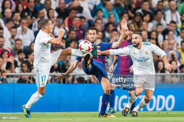 MADRID SPAIN AUGUST 16 Sergio Busquets Burgos of FC Barcelona competes for the ball with Lucas Vazquez and Daniel Carvajal Ramos of Real Madrid...