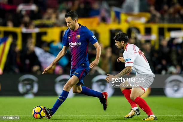 Sergio Busquets Burgos of FC Barcelona fights for the ball with Ever Maximiliano Banega of Sevilla FC during the La Liga 201718 match between FC...