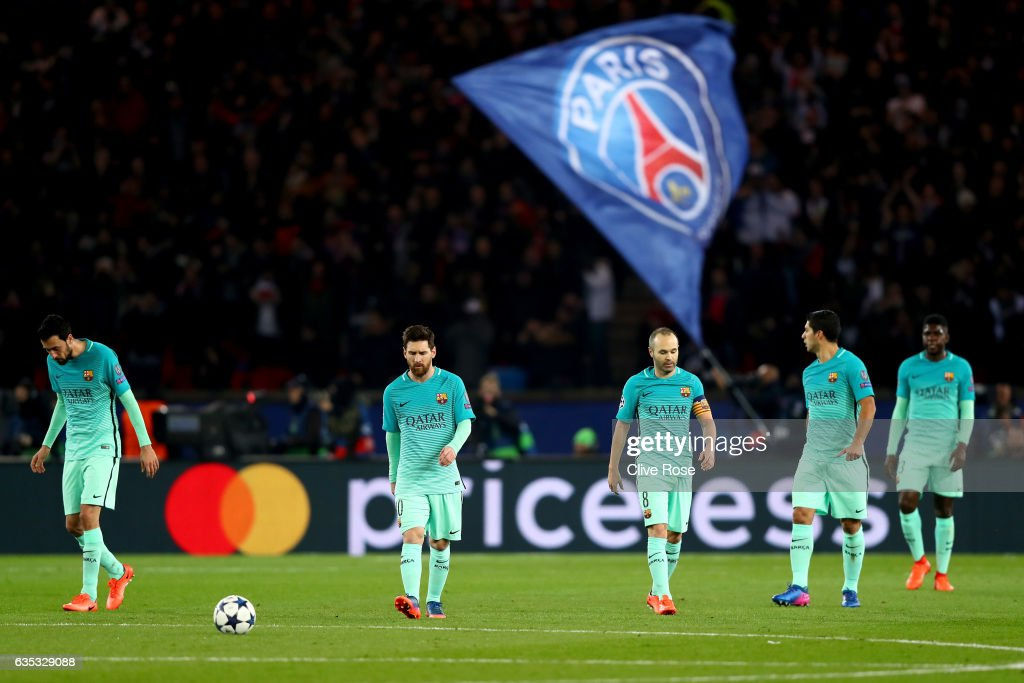 L-R) Sergio Busquets, Lionel Messi, Andres Iniesta, Luis Suarez and Samuel Umtiti of Barcelona react after conceding a goal during the UEFA Champions League Round of 16 first leg match between Paris Saint-Germain and FC Barcelona at Parc des Princes on February 14, 2017 in Paris, France.