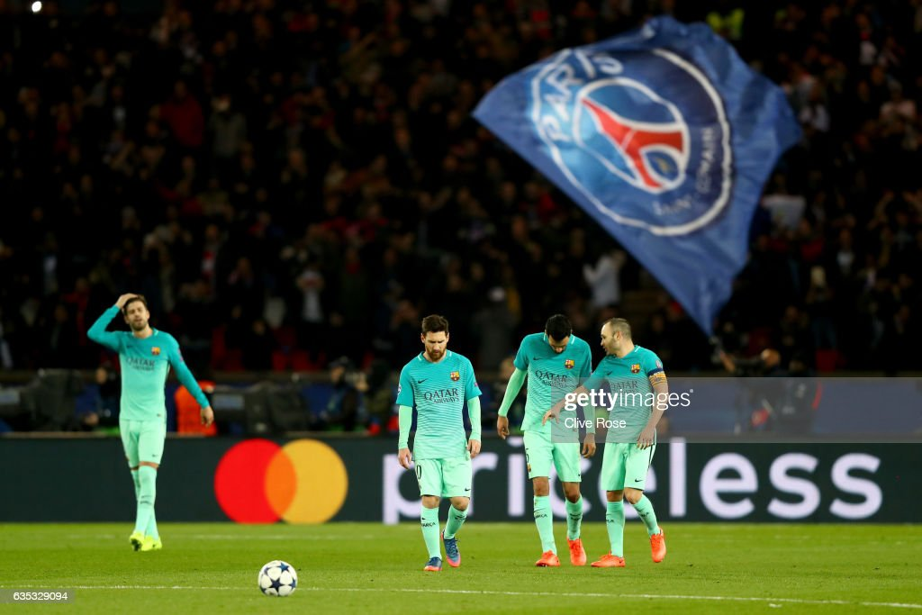 L-R) Sergio Busquets, Lionel Messi, Andres Iniesta, Luis Suarez of Barcelona react after conceding a goal during the UEFA Champions League Round of 16 first leg match between Paris Saint-Germain and FC Barcelona at Parc des Princes on February 14, 2017 in Paris, France.