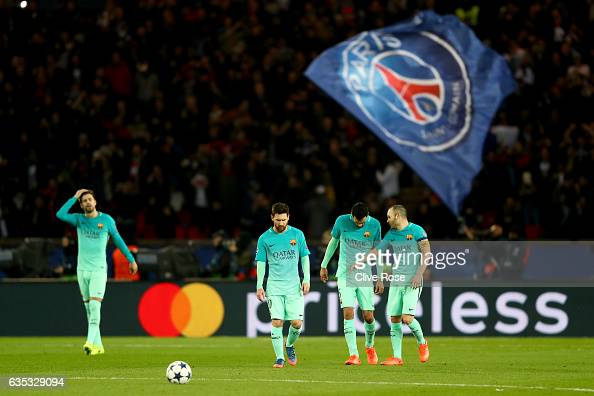 R Sergio Busquets Lionel Messi Andres Iniesta Luis Suarez of Barcelona react after conceding a goal during the UEFA Champions League Round of 16...