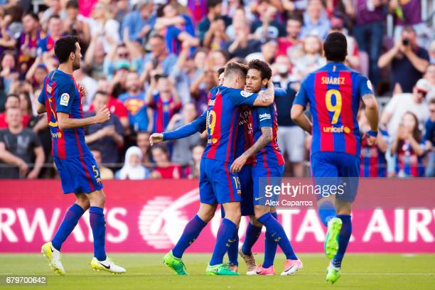 Sergio Busquets Lionel Messi Lucas Digne Neymar Santos Jr and Luis Suarez of FC Barcelona celebrate after Lionel Messi scored their team's second...