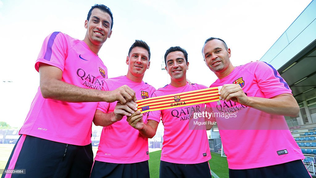 <a gi-track='captionPersonalityLinkClicked' href=/galleries/search?phrase=Sergio+Busquets&family=editorial&specificpeople=5477015 ng-click='$event.stopPropagation()'>Sergio Busquets</a>, <a gi-track='captionPersonalityLinkClicked' href=/galleries/search?phrase=Lionel+Messi&family=editorial&specificpeople=453305 ng-click='$event.stopPropagation()'>Lionel Messi</a>,Barcelona Vice Captains with Barcelona Captain Xavi and <a gi-track='captionPersonalityLinkClicked' href=/galleries/search?phrase=Andres+Iniesta&family=editorial&specificpeople=465707 ng-click='$event.stopPropagation()'>Andres Iniesta</a>,Barcelona Vice Captain during training at the Ciutat Esportiva Joan Gamper training ground on August 7, 2014 in Barcelona,Spain.