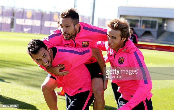 Sergio Busquets Martin Montoya and Sergi Samper of Barcelona take part in an exercise during the FC Barcelona training session at Ciutat Esportiva on...