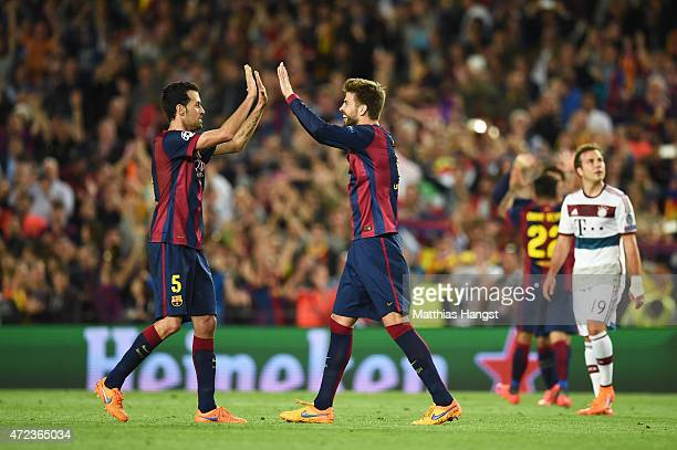 Sergio Busquets of Barcelona and Gerard Pique of Barcelona celebrate following their team's 30 victory during the UEFA Champions League Semi Final...