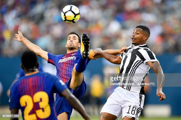 Sergio Busquets of Barcelona and Mario Lemina of Juventus in action during the International Champions Cup match between Juventus and Barcelona at...