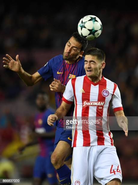 Sergio Busquets of Barcelona and Sasa Zdjelar of Olympiakos compete for the ball during the UEFA Champions League group D match between FC Barcelona...