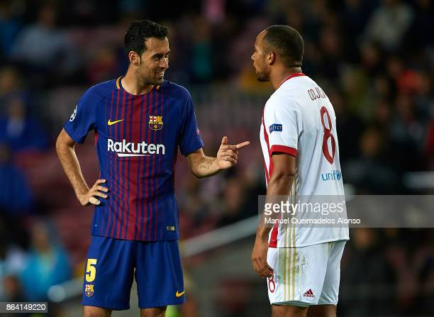 Sergio Busquets of Barcelona argues with Vadis Odjidja of Olympiakos Piraeus during the UEFA Champions League group D match between FC Barcelona and...