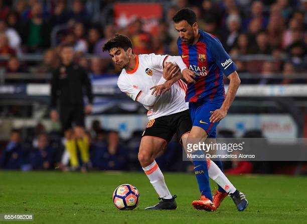 Sergio Busquets of Barcelona competes for the ball with Carlos Soler of Valencia during the La Liga match between FC Barcelona and Valencia CF at...