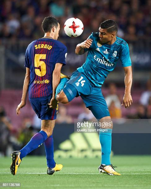 Sergio Busquets of Barcelona competes for the ball with Casemiro of Real Madrid during the Supercopa de Espana Supercopa Final 1st Leg match between...