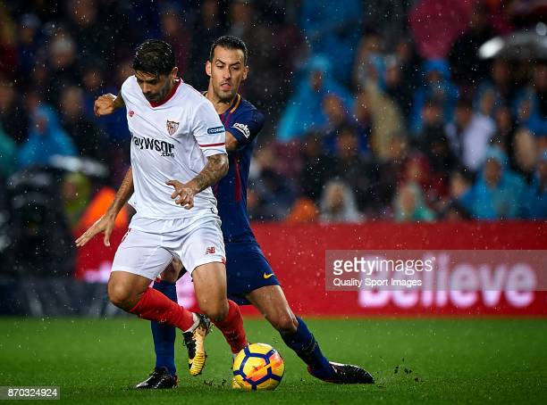 Sergio Busquets of Barcelona competes for the ball with Ever Banega of Sevilla during the La Liga match between Barcelona and Sevilla at Camp Nou on...