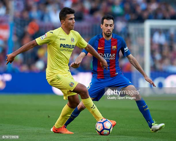 Sergio Busquets of Barcelona competes for the ball with Rodrigo Hernandez of Villarreal during the La Liga match between FC Barcelona and Villarreal...