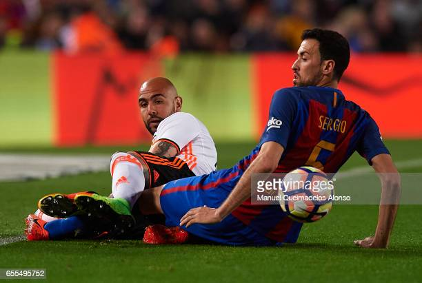 Sergio Busquets of Barcelona competes for the ball with Simone Zaza of Valencia during the La Liga match between FC Barcelona and Valencia CF at Camp...