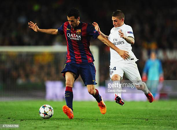 Sergio Busquets of Barcelona holds off Marco Verratti of PSG during the UEFA Champions League Quarter Final second leg match between FC Barcelona and...