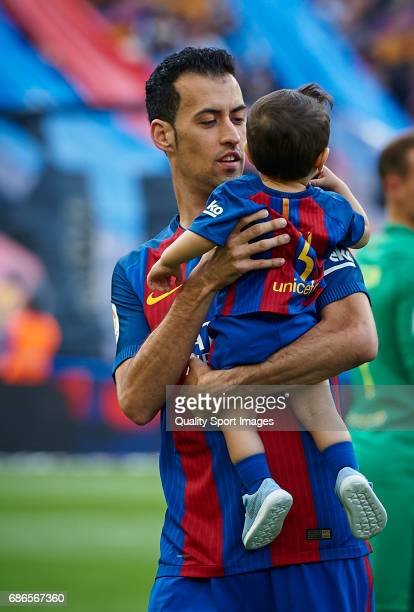 Sergio Busquets of Barcelona with his children prior the La Liga match between FC Barcelona and SD Eibar at Camp Nou Stadium on May 21 2017 in...