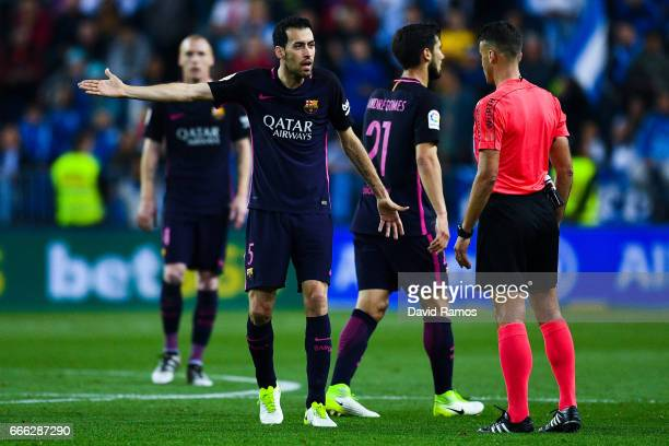 Sergio Busquets of FC Barcelona argues with the referee during the La Liga match between Malaga CF and FC Barcelona at La Rosaleda stadium on April 8...