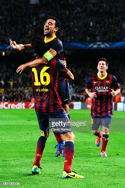 Sergio Busquets of FC Barcelona celebrates with his teammate Xavi Hernandez of FC Barcelona after scoring his team's second goal during the UEFA...