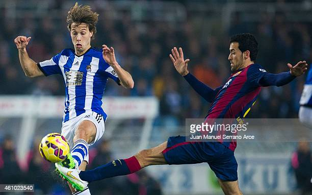 Sergio Busquets of FC Barcelona duels for the ball with Sergio Canales of Real Sociedad during the La Liga match between Real Sociedad and Barcelona...