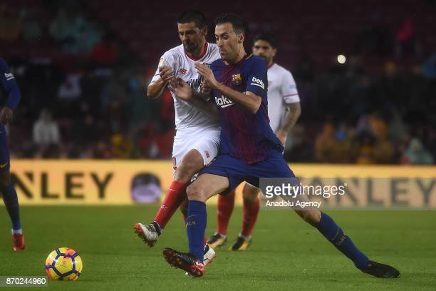 Sergio Busquets of FC Barcelona in action against Ever Banega of Sevilla FC during the Spanish league football match between FC Barcelona and Sevilla...