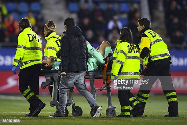 Sergio Busquets of FC Barcelona leaves the pitch on a stretcher after being injured during the La Liga match between SD Eibar and FC Barcelona at...