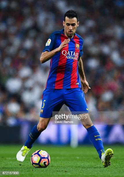 Sergio Busquets of FC Barcelona runs with the ball during the La Liga match between Real Madrid CF and FC Barcelona at the Santiago Bernabeu stadium...