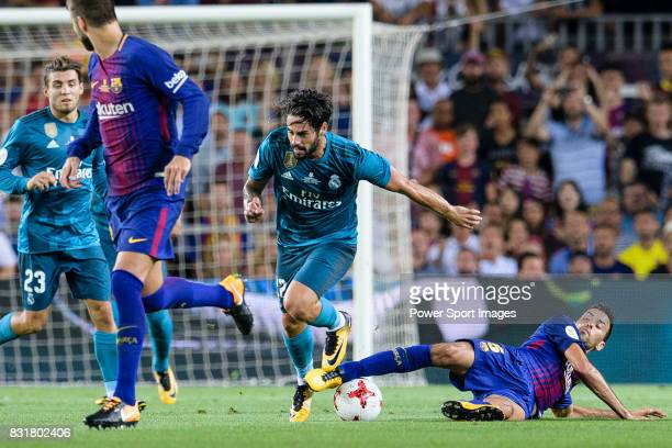 Sergio Busquets of FC Barcelona trips up with Isco Alarcon of Real Madrid during the Supercopa de Espana Final 1st Leg match between FC Barcelona and...