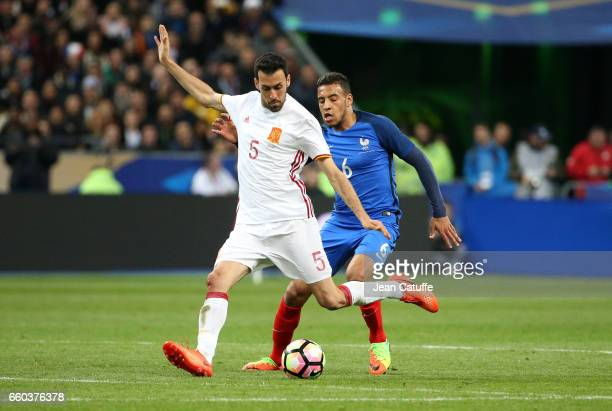Sergio Busquets of Spain and Corentin Tolisso of France in action during the international friendly match between France and Spain between France and...