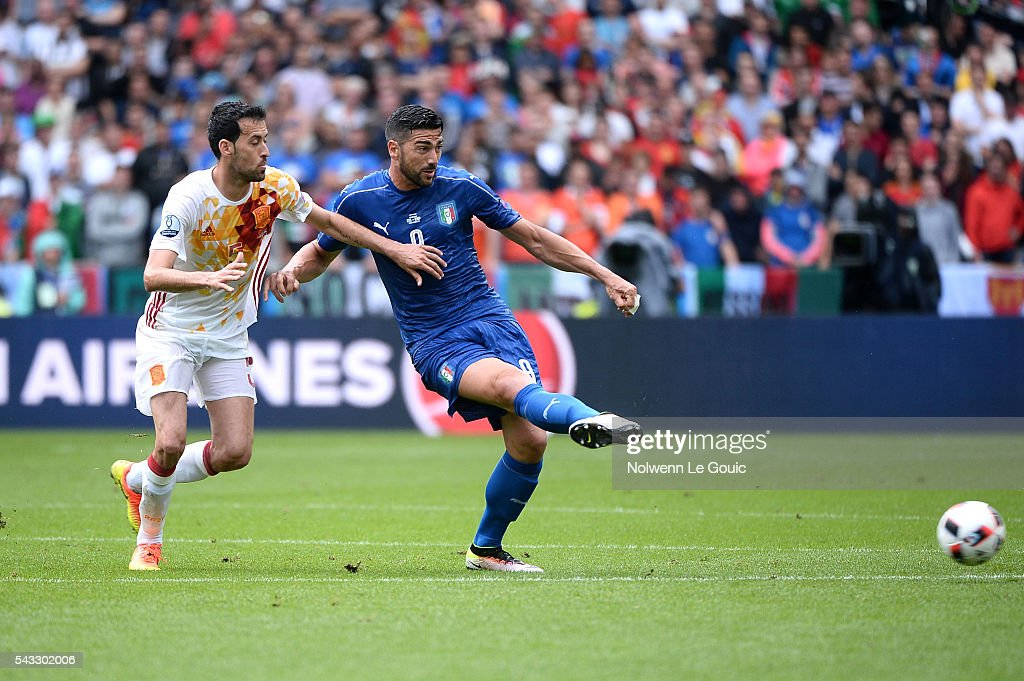 Sergio Busquets of Spain and Graziano Pelle of Italy during the European Championship match Round of 16 between Italy and Spain at Stade de France on June 27, 2016 in Paris, France.