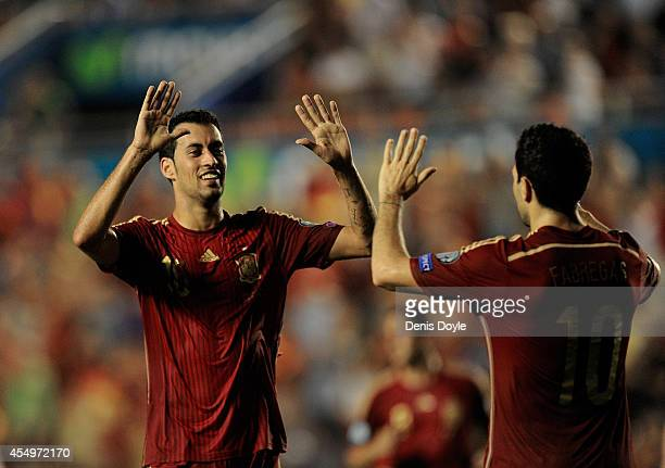 Sergio Busquets of Spain celebrates with Cesc Fabgegas after scoring Spain's 3rd goal during the UEFA EURO 2016 Group C Qualifier between Spain and...