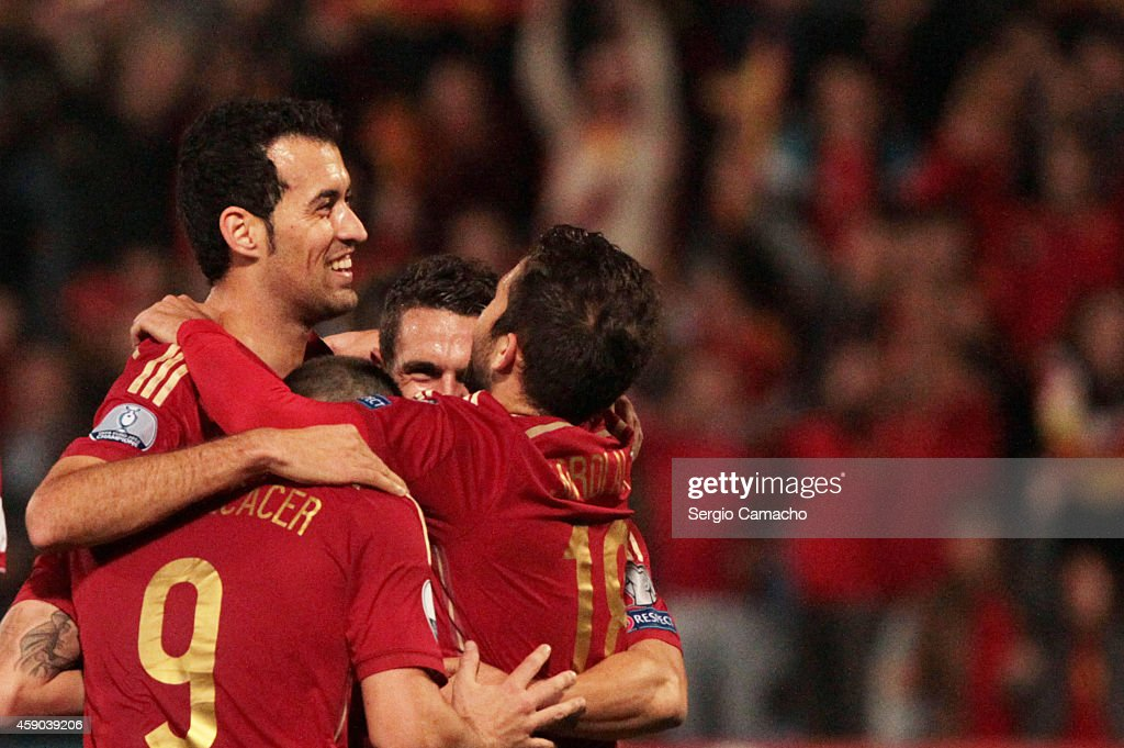 Sergio Busquets of Spain celebrates with his teammates after scoring during the UEFA EURO 2016 Group C Qualifier football match between Spain and...