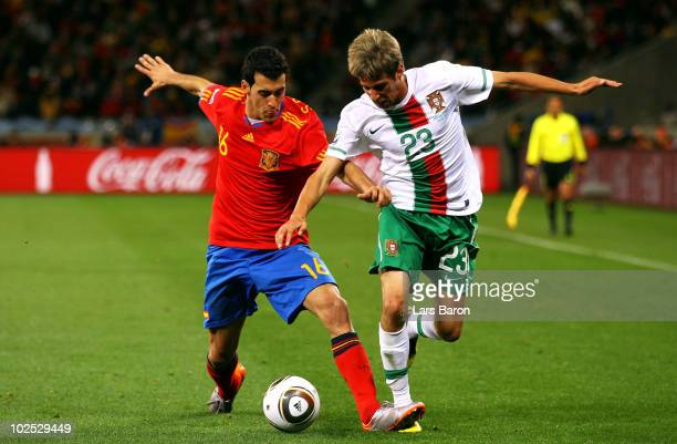 Sergio Busquets of Spain challenges Fabio Coentrao of Portugal during the 2010 FIFA World Cup South Africa Round of Sixteen match between Spain and...