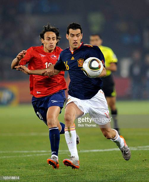 Sergio Busquets of Spain chases Jorge Valdivia of Chile during the 2010 FIFA World Cup South Africa Group H match between Chile and Spain at Loftus...